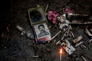 A photo of an Afghan man is discarded with used matches and foil used for smoking heroin at the old Soviet Cultural Centre in Kabul, Afghanistan on July 16, 2008. © Adam Ferguson