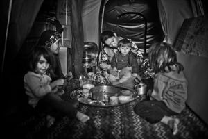 "People in Domiz camp describe that at first the conflicts started between local people and after that it was a big issue and spread the whole Syria. The mother says, ""My children has seen the violence and death in front of them."" © Khaled Hasan"