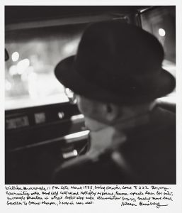 William Burroughs, 11pm late March 1985, being driven home 222 Bowery. Experimenting with hand held half-second rolliflex exposure camera upside down box view, Burroughs phantom in street light stop sign illumination fuzzy, couldnt move back further to focus sharper, I was in rear seat. © Allen Ginsberg
