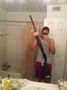 "Sharrod's selfie (rifle). From the series ""I slowly watched him disappear"" © Jason Hanasik"