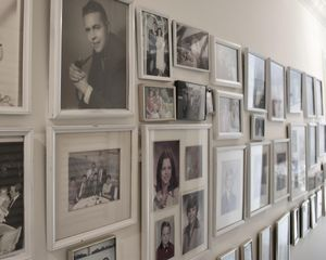One of several walls of photos in Nanny's home.