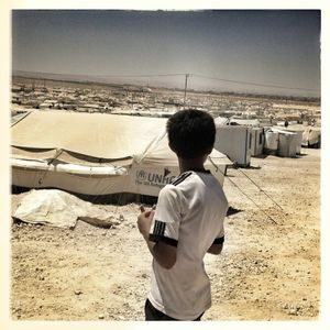 A young boy looks out over Za'atari