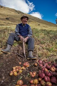 """Farmers (""""campesinos"""") harvesting potatoes in the remote community of Huamanachoque in the Andes"""