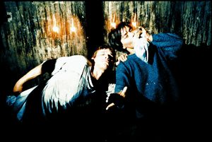 February 1998, Brancoveanu canal. Florie's birthday, Mia and Laurentzio having drugs, a little while after Mia felt bad because of all the drugs she had. She lied on the floor calling for help. Most of the children around didn't listen to her, until one of them seemed to care for her, shaking her to wake her up, from Survival Under © Flore-Aël Surun (France), from the exhibition Beyond Walls: Eastern Europe after 1989. Courtesy of Tendance Floue, France and the Noorderlicht Photofestival 2008.