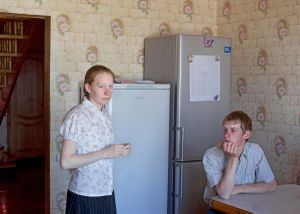 One day before the singer festival. Brother and sister shortly before the final rehearsal. Petrovka, Omsk Oblast, Russia 2014