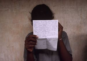 Uma reads a letter from home at the Methsevana Government Rehabilitation Center for Girls in Nugegoda, Sri Lanka, 1999. Country: Sri Lanka, Born: 1982 Served: Liberation Tigers of Tamil Eelam, Conflict: Tamil Insurgency (Sri Lanka Civil War) 1983-2003. © Lori Grinker, courtesy of Nailya Alexander Gallery