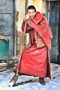 Snow shoveling monk