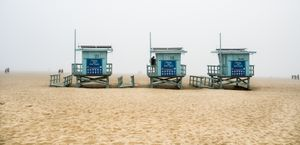 lovers hidden on cloudy day at the beach
