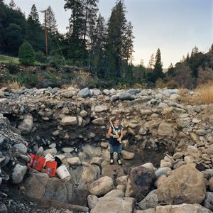 Avery in his digging hole by the Scott River, Klamath National Forest, California, 2009. © Sarina Finkelstein