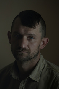 Rostyk, 34, engineer, picture was taken after he spent 12 months in the war zone, July 2015, Ukraine.