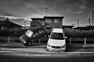 """Cars parked by the Tsunami, from the series Fukushima """"No Go"""" Zone, © Pierpaolo Mittica."""