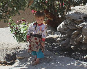 The complexities of life for a child living in Asian countries can be seen in this colourful photo of an Afghan child