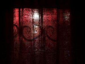 Sunlight and shadows. Through the Curtains
