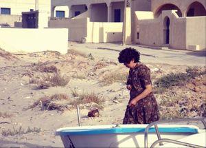 Mum walking in a boat