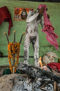 The saint ascetics, sadhus, cover their bodies with an ash to pray and meditate.