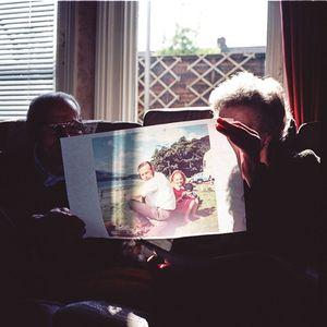 Parents looking at old holiday prints