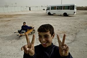 Two boys fooling around at the camp's main entrance. © Tom Verbruggen