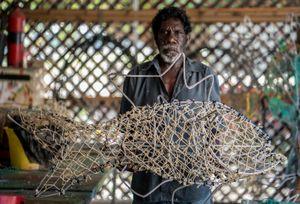 Michael Norman, Elder and Artist, with Ghost Net sculpture