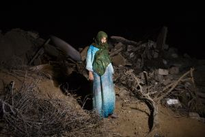 Sabeeha Abu Rouk, 60, at her destroyed home in Khan Yunis by Israeli airstrike and bulldozers during the summer's 50-day war between Israel and Hamas. She stays at the site with her family embers, since there is no place else for them to move, or too expensive for the rent after the war.