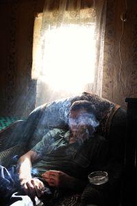 Itari from Mirashkhani smokes a cigarette.