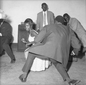 © Malick Sidibé, Dance the Twist, 1965, gelatin silver print, 50 x 60 cm. Courtesy of Fifty One Fine Art Photography.