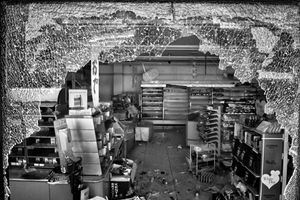 """Market devastated by thieves, Namie city, from the series Fukushima """"No Go"""" Zone, © Pierpaolo Mittica."""