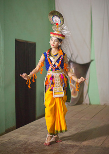 Ras Lila dancer of Manipur. A girl dressed as Krishna poses before a performance of the Maha Ras Lila.