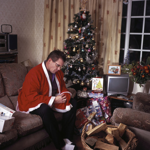 Jon Ison at home in Birmingham, waiting for his child, who never arrived to celebrate Christmas. Birmingham, UK. 25 December 2011