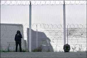 Calais, migrants Jungle, the fence alongside the way to the port.