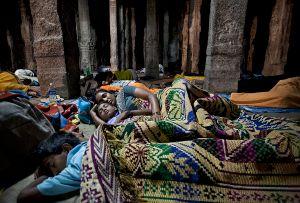 Hampi, India: During the traditional religious festival countless pilgrims sleep in the Virupaksha Temple. © Matjaz Krivic