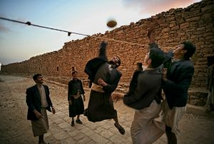 Thula, Yemen: Young boys playing volleyball in the quiet streets of the historic town. © Matjaz Krivic