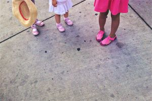 three girls with pink shoes