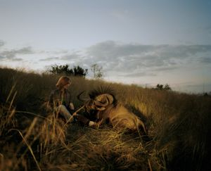 huntress with wildebeest, namibia-from the series 'hunters'-David Chancellor