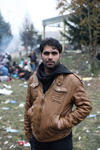 A former cameraman Reza from Iraq (32 years old) waiting on the no-mans land between Slovenia and Austria.