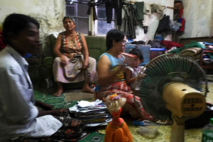 Two to three families live in one apartment at Yuzana Garden City, Yangon, Myanmar.