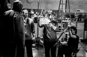 Second assistant camera Patrick Dingman, slates a scene.