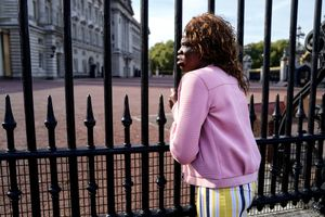 Woman in front of Buckingham Palace
