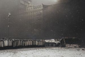 After the clashes with the protesters riot police protected APC which takes away burned buses from the carriageway in the center of Kiev on Jan. 22, 2014.