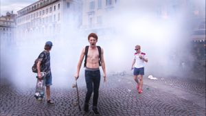Marseille, France (2016). England supporters emerge from teargas during clashes with rival Russian fans and French police at the Vieux Port in Marseille.