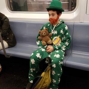 """Baby Leprechaun sighting on the 5 Train"""