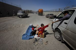 A woman and her children beg along the new road leading to Bagram. © Michael Christopher Brown