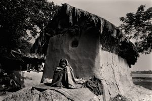 Durgabadda Mondol (50) is the sole earner of the family. He and his family have been suffering from numerous diseases during the past few months. His daughter-in-law, unwell, sits outside in the sun. Chuna, Satkhira. © Munem Wasif/VU'