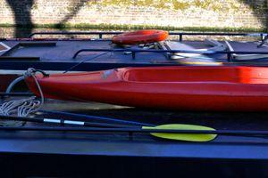 Lifebelt, Kayak And Paddles