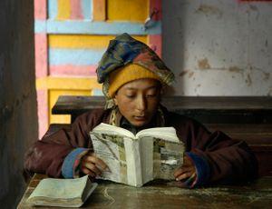 Nomad boy reading, Ponru School, Kham, Sichuan. China. 2005.