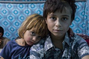 Tomas with his sister Solin. Solin (3) was kidnapped in the summer of 2014 when she was only six months old. She now resides in Kabartū refugee camp outside of Duhok with her two sisters and three brothers.
