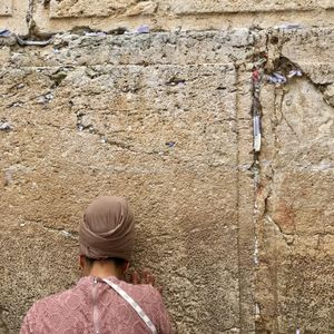 Woman praying at the Western Wall, Jerusalem