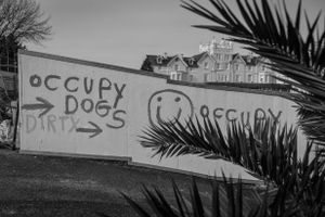The landlords paint slogans on the outside walls of the camp.