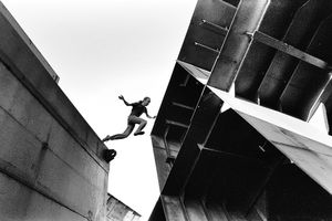 A young man is jumping on top of structures at an abandoned ships graveyard, Kronstadt Naval Base, Russia, May 2005