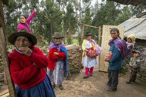Benita Pariona de Arango (on the left) in her house with her daughter and some of their neighbors. In 1984 soldiers killed Benita's husband, Filemón Arango Soca. Seven years later the Shining Path killed her oldest son. Another of her sons, along with twenty others, was killed by the police. Ñuñunhuaycco, Ayacucho Region, 2014