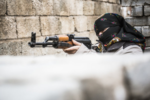 A female guerilla fighter of the YPS while training between high barricades in Kurdish-dominated city of Nusaybin in southeast Turkey, near the Syrian border. Heavy gunfights took place during several curfews between Turkish government special forces and Kurdish YPS guerilla fighters.